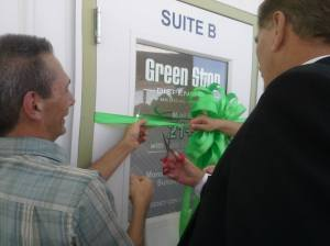 Ronn Nixon and Log Lane Village Mayor Ed Parker cutting the ribbon at Green Stop, the first marijuana dispensary in Morgan County.