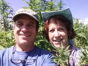 Greg Duran and Teri Robnett (Rx MaryJane) in a Colorado hemp field.